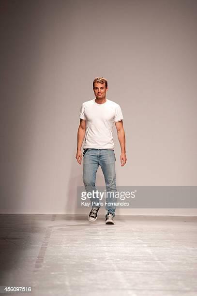 Christian Wijnants walks the runway during the Christian Wijnants show as part of the Paris Fashion Week Womenswear Spring/Summer 2015 on September...