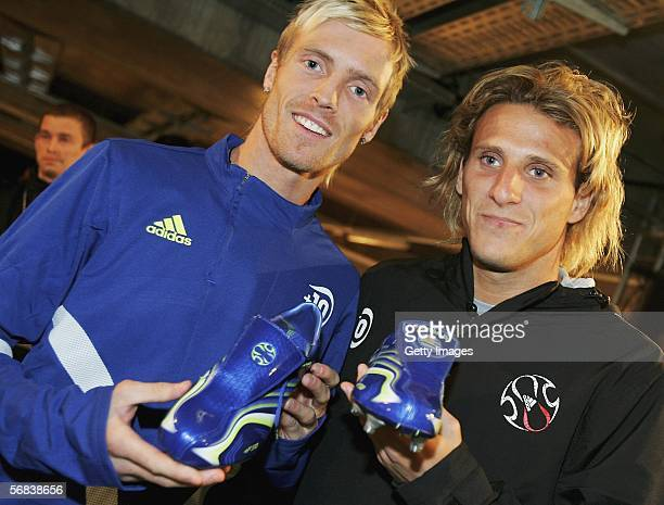 Christian Wilhelmsson poses with Diego Forlan and their new F50 Tunit shoes during the Major adidas F50 Tunit Launch Event on February 13 2006 in...