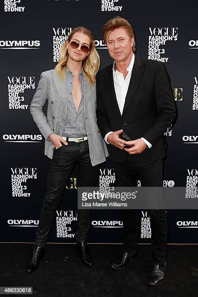 Christian Wilkins and Richard Wilkins arrive at the Vogue Fashion's Night Out on September 3 2015 in Sydney Australia