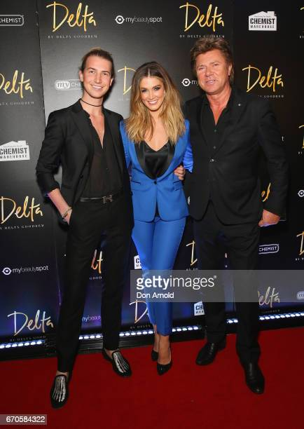 Christian Wilkins Delta Goodrem and Richard Wilkins pose at the launch of Delta by Delta Goodrem on April 20 2017 in Sydney Australia