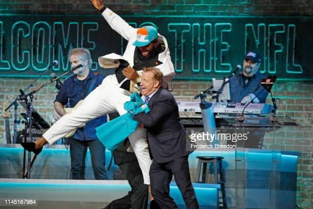 Christian Wilkins jump into NFL Commissioner Roger Goodell after he is drafted thirteenth overall by the Miami Dolphins on day 1 of the 2019 NFL...