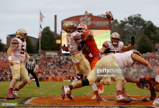 Christian Wilkins of the Clemson Tigers hits James Blackman of the Florida State Seminoles in the endzone during their game at Memorial Stadium on...