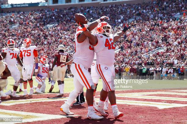 Christian Wilkins of the Clemson Tigers reacts after rushing for a oneyard touchdown in the second quarter of the game against the Florida State...