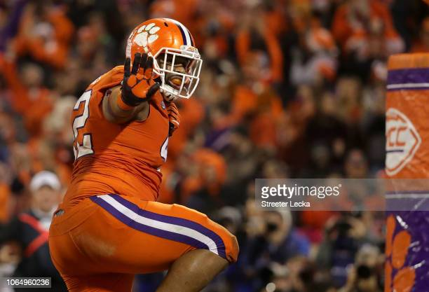 Christian Wilkins of the Clemson Tigers reacts after scoring a touchdown during their game against the South Carolina Gamecocks at Clemson Memorial...