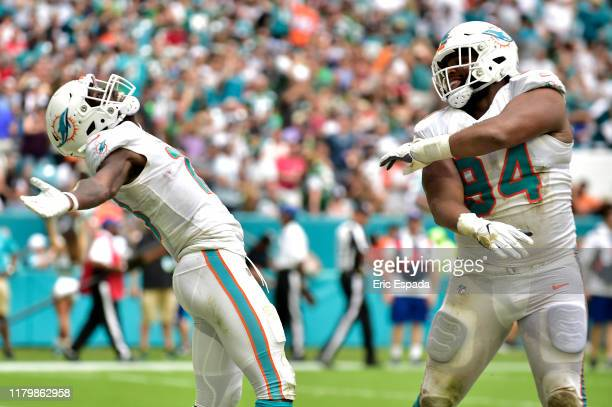 Christian Wilkins of the Miami Dolphins celebrates with Preston Williams after scoring a touchdown in the second quarter against the New York Jets at...