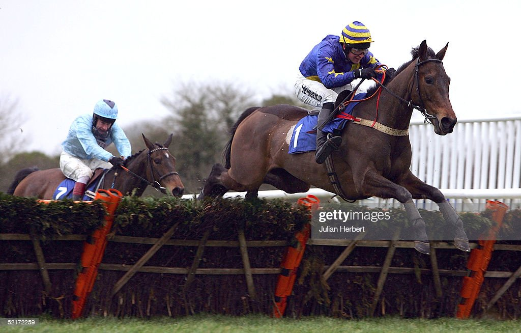 Christian Williams and Darjeeling lead the Mick Fitzgerald ridden Foxchapel Queen over the last flight to land The coralpoker.com EBF Mares Only Hurdle Race run at Wincanton Racecourse on February 10, 2005 in Wincanton, England.