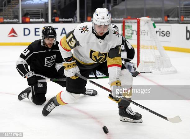 Christian Wolanin of the Los Angeles Kings watches as Tomas Jurco of the Vegas Golden Knights gets control of the puck during the first period at...