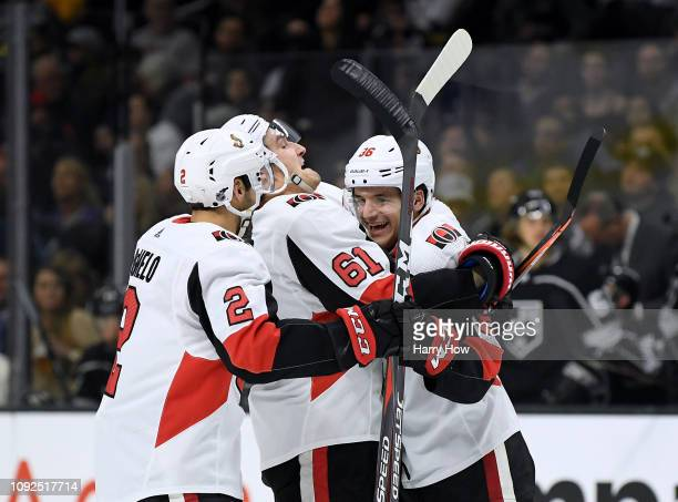 Christian Wolanin of the Ottawa Senators celebrates his unassisted goal with Mark Stone and Dylan DeMelo of the Ottawa Senators to take a 31 lead...