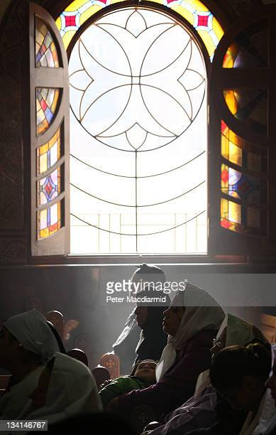 Christian women attend a service in Saint Mark Coptic Orthodox Church in Giza on November 27 2011 in Greater Cairo Egypt There are an estimated 10...