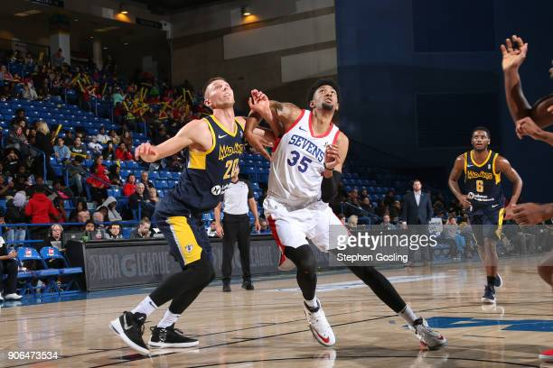 Christian Wood of the Delaware 87ers fights for positioning against Jarrod Uthoff of the Fort Wayne Mad Ants during a GLeague at the Bob Carpenter...