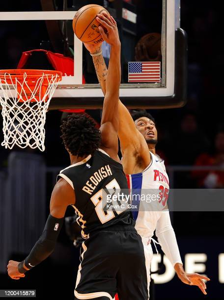 Christian Wood of the Detroit Pistons blocks a dunk attempt by Cam Reddish of the Atlanta Hawks in the first half at State Farm Arena on January 18...
