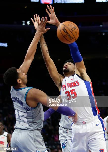Christian Wood of the Detroit Pistons defemds against PJ Washington of the Charlotte Hornets during the second half at Little Caesars Arena on...