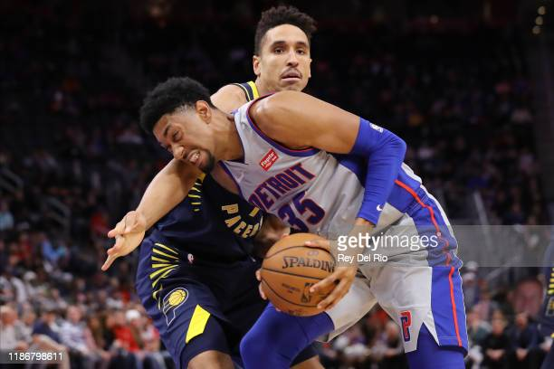 Christian Wood of the Detroit Pistons drives to the basket and draws a foul from Malcolm Brogdon of the Indiana Pacers in the third quarter at Little...