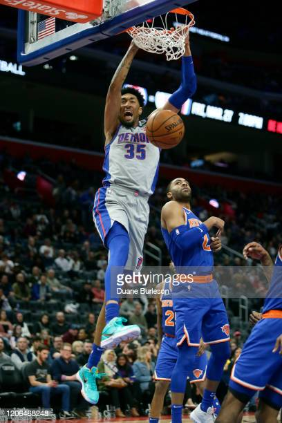 Christian Wood of the Detroit Pistons dunks against Wayne Ellington of the New York Knicks during the second half at Little Caesars Arena on February...