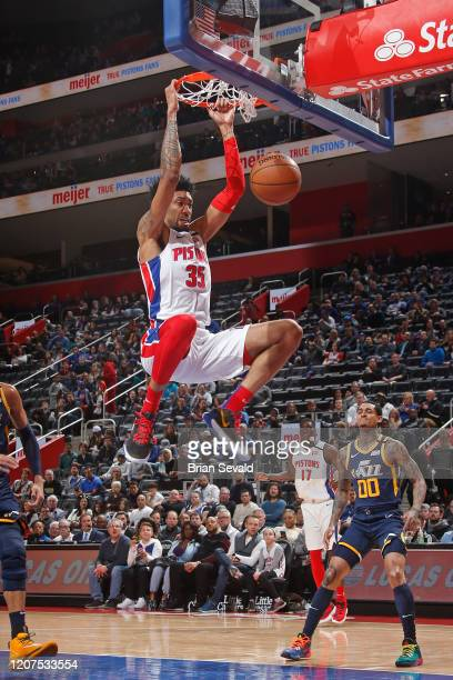 Christian Wood of the Detroit Pistons dunks the ball during the game against the Denver Nuggets on March 7 2020 at Little Caesars Arena in Detroit...