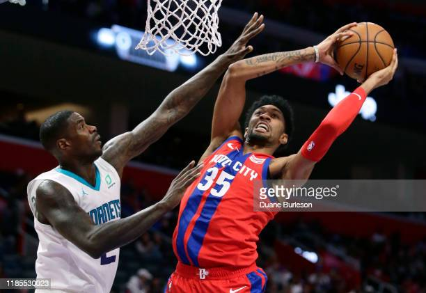 Christian Wood of the Detroit Pistons goes to the basket against Marvin Williams of the Charlotte Hornets during the second half at Little Caesars...