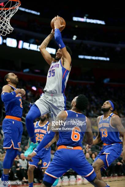Christian Wood of the Detroit Pistons goes up to dunk against Wayne Ellington Elfrid Payton and Mitchell Robinson of the New York Knicks during the...