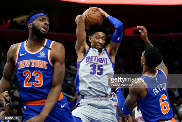 Christian Wood of the Detroit Pistons grabs a rebound against Mitchell Robinson and Elfrid Payton of the New York Knicks during the first half at...