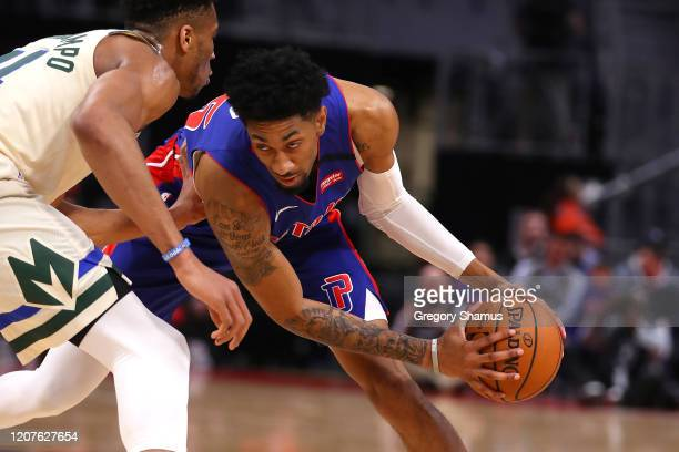 Christian Wood of the Detroit Pistons looks to make a mover around Giannis Antetokounmpo of the Milwaukee Bucks during the first half at Little...