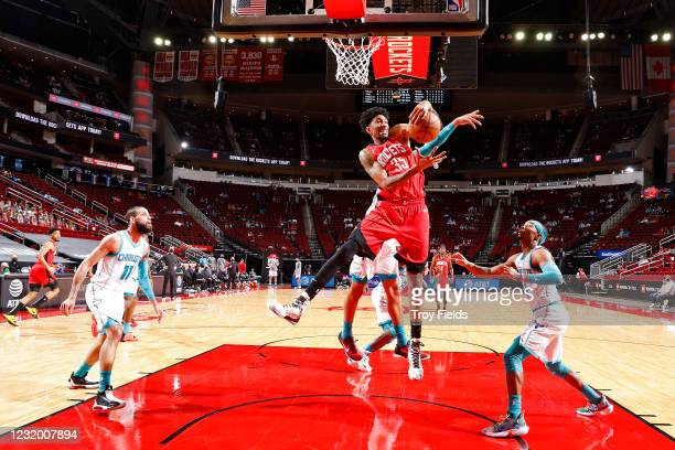 Christian Wood of the Houston Rockets rebounds the ball during the game against the Charlotte Hornets on March 24, 2021 at the Toyota Center in...