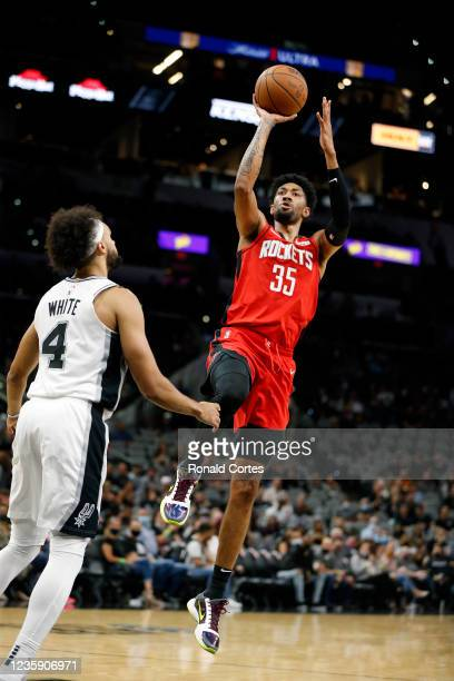 Christian Wood of the Houston Rockets shoots over Derrick White of the San Antonio Spurs in a pre-season game at AT&T Center on October 2, 2021 in...