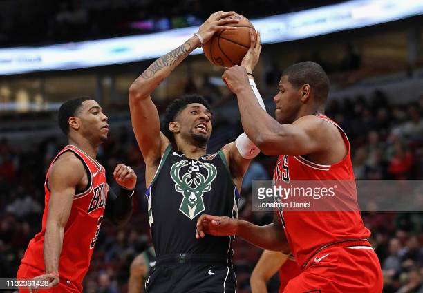 Christian Wood of the Milwaukee Bucks drives between Shaquille Harrison and Cristiano Felicio of the Chicago Bulls at the United Center on February...