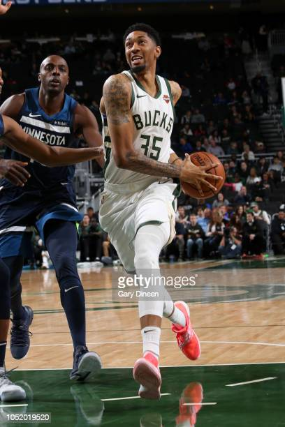 Christian Wood of the Milwaukee Bucks drives to the basket against the Minnesota Timberwolves during a preseason game on October 12 2018 at Fiserv...