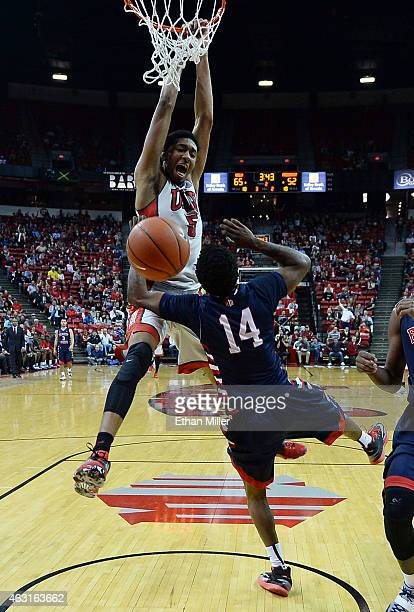 Christian Wood of the UNLV Rebels dunks against Julien Lewis of the Fresno State Bulldogs during their game at the Thomas Mack Center on February 10...