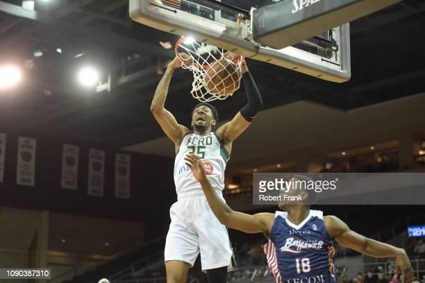 Christian Wood of the Wisconsin Herd dunks over Jordan Sibert of the Erie BayHawks at the Erie Insurance Arena on January 27 2019 in Erie...