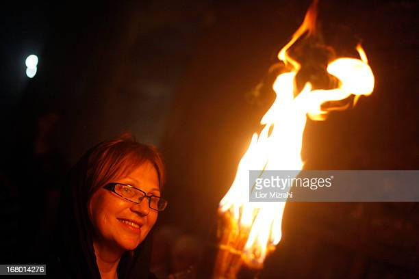 A Christian worshiper holds a candle lit from a flame that emerged from the tomb believed to be of Jesus Christ as they take part in the ceremony of...