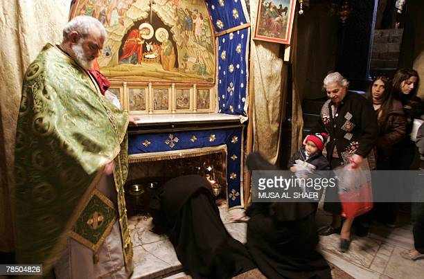 Christian worshipers and clergy pray in the Grotto at the Church of the Nativity, the alleged birth place of Jesus Christ, in the West Bank town of...