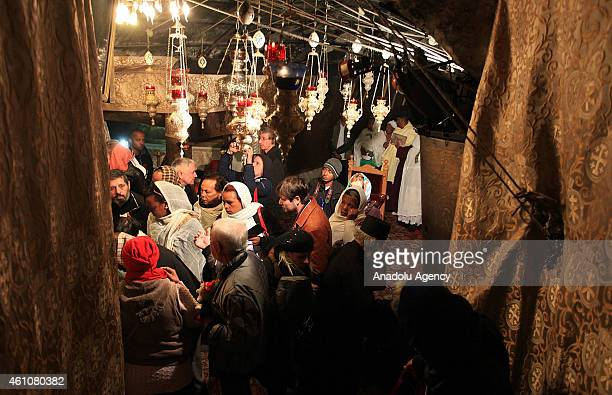 Christian worshipers arrive at the Church of the Nativity believed to be the birth place of Jesus Christ in West Bank town of Bethlehem on January 6...