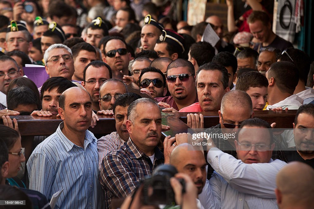 Christian worshipers carry a wooden cross along the Via Dolorosa (Way of Suffering) during the Good Friday procession on March 29, 2013 in Jerusalem's Old City, Israel. Good Friday is celebrated by Christians throughout the world as the day Christ was crucified on the cross in the lead up to his resurrection on Easter.