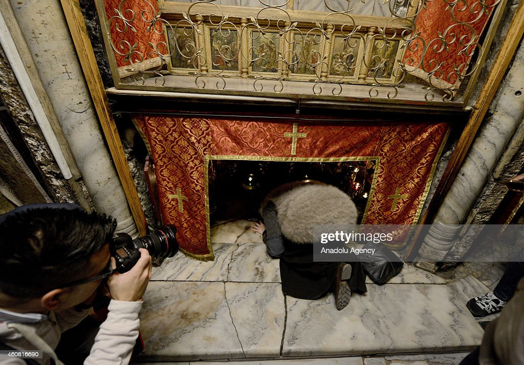 Christian worshipers look inside the Grotto at the Church of the Nativity, believed to be the birthplace of Jesus Christ, in the biblical town Bethlehem, West Bank on December 24, 2014.