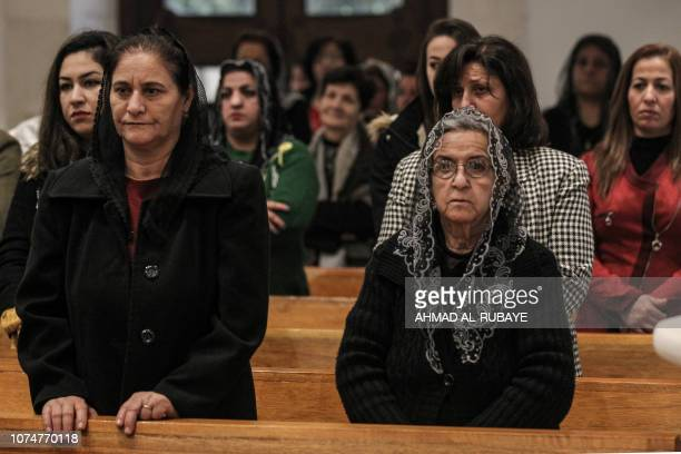 Christian worshippers attend Christmas morning mass at the Mar Addai Chaldean Catholic Church in the predominantly Iraqi Christian town of Qaraqosh,...