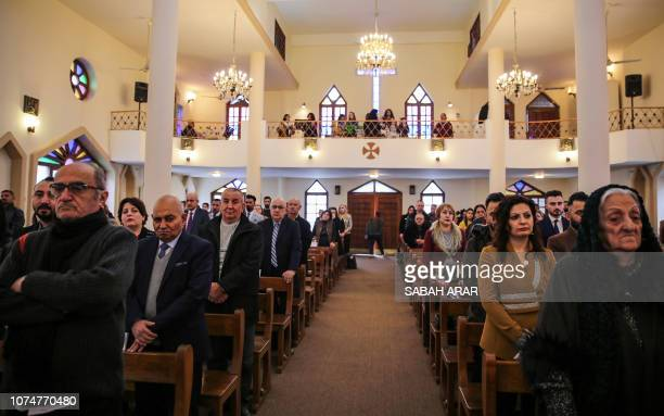 Christian worshippers attend Christmas morning mass at the Syriac Catholic Church of Our Lady of Salvation in the Iraqi capital Baghdad's Karrada...