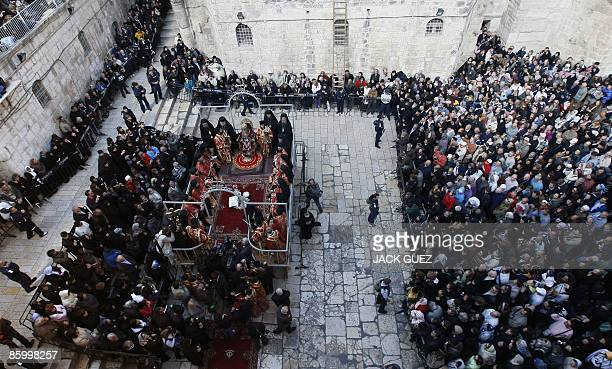 Christian worshippers attend the Christian Orthodox Washing of the Feet Easter ceremony in front of the Church of the Holy Sepulchre in Jerusalem's...