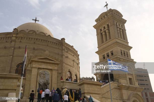 Christian worshippers attend the Good Friday epitaphios procession outside the 10th century Greek Orthodox Church of St George in the Old Cairo...