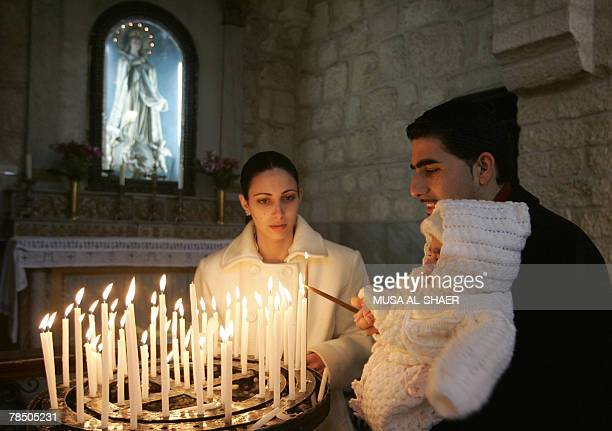 Christian worshippers light candles at the Church of the Nativity the alleged birth place of Jesus Christ in the West Bank town of Bethlehem 16...