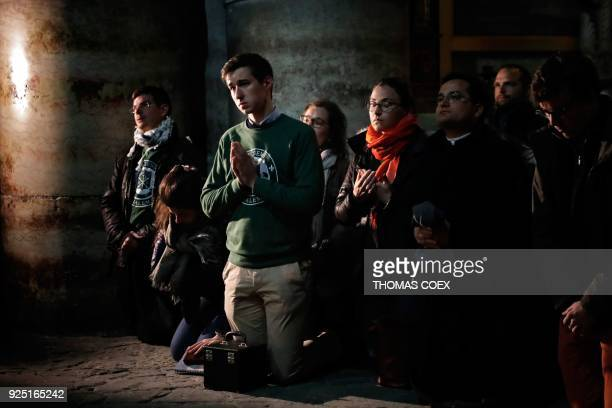 Christian worshippers pray inside the Church of the Holy Sepulchre in Jerusalem after it reopened on February 28 following a threeday closure to...