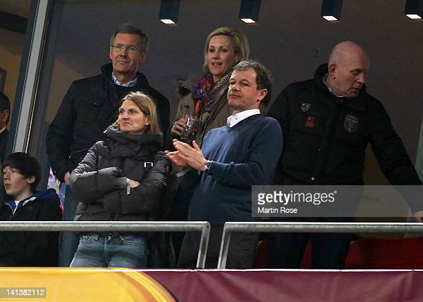 Christian Wulff and his wife Bettina are seen during the UEFA Europa League second leg round of 16 match between Hannover 96 and Standard Liege at...