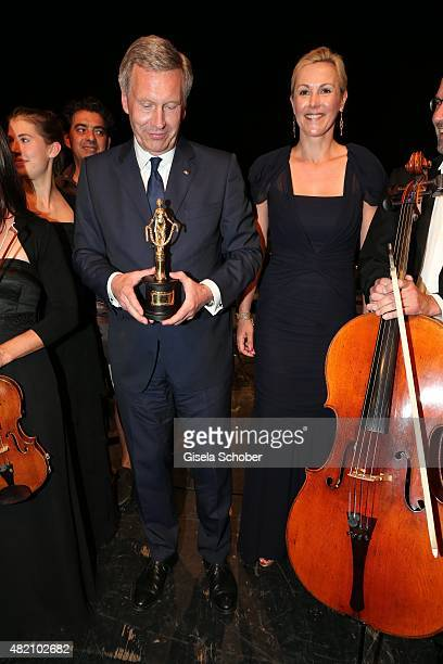 Christian Wulff with award and his wife Bettina Wulff during the 'Die Goldene Deutschland' Gala on July 26 2015 at Cuvillies Theater in Munich Germany