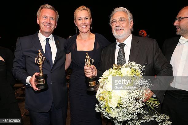 Christian Wulff with award and his wife Bettina Wulff Placido Domingo during the 'Die Goldene Deutschland' Gala on July 26 2015 at Cuvillies Theater...