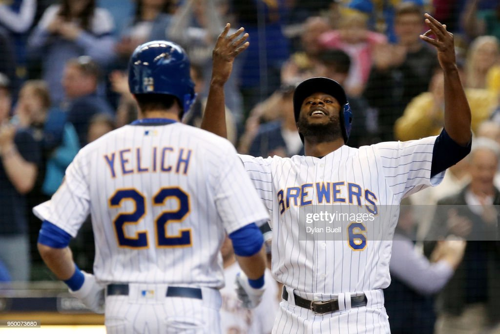 Christian Yelich #22 and Lorenzo Cain #6 of the Milwaukee Brewers celebrate after Yelich hit a home run in the fourth inning against the Miami Marlins at Miller Park on April 22, 2018 in Milwaukee, Wisconsin.