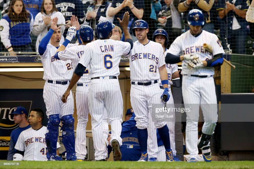 Christian Yelich #22 and Lorenzo Cain #6 of the Milwaukee Brewers celebrate with teammates after Yelich hit a home run in the fourth inning against the Miami Marlins at Miller Park on April 22, 2018 in Milwaukee, Wisconsin.