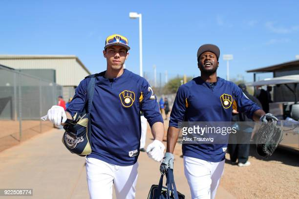 Christian Yelich and Lorenzo Cain of the Milwaukee Brewers walk to the field during workouts on Wednesday February 21 2018 at the Maryvale Baseball...