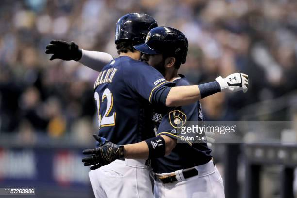 Christian Yelich and Mike Moustakas of the Milwaukee Brewers celebrate after Yelich hit a home run in the fourth inning against the Cincinnati Reds...