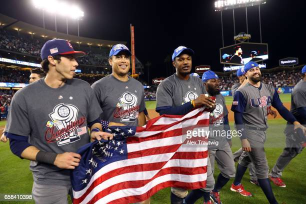 Christian Yelich Giancarlo Stanton and Adam Jones of Team USA celebrate on field after winning Game 3 of the Championship Round of the 2017 World...