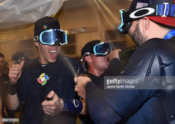 Christian Yelich of team United States celebrates in the locker room after their 80 win over Puerto Rico during Game 3 of the Championship Round of...