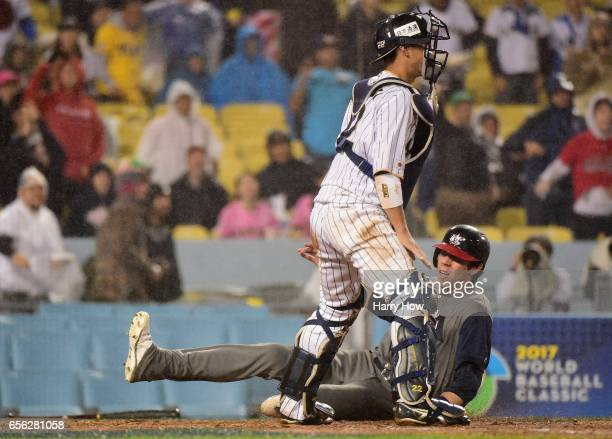 Christian Yelich of team United States slides home for 10 lead in the fourth inning against Seiji Kobayashi of team Japan during Game 2 of the...
